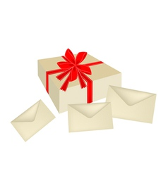 A Gift Box with Red Ribbon and Three Cards vector image vector image