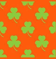 clover pattern on an orange background vector image