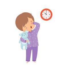 Cute sleepy boy wearing pajamas standing with vector