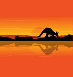 Silhouette kangaroo on river landscape vector
