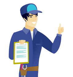 Asian mechanic with clipboard giving thumb up vector