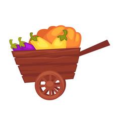 Vegetable fresh organic harvest in wooden cart vector