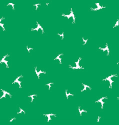 silhouettes of deer on green background seamless vector image