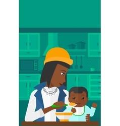 Woman feeding baby vector image