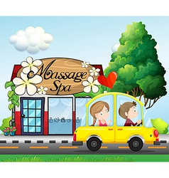 A couple riding in a car near the massage spa vector image