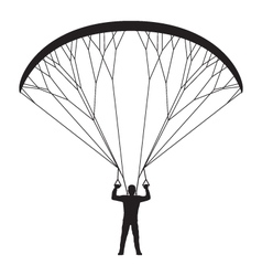 Black silhouette of a man with a paraglider vector image vector image