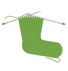 Knitted sock on the needles vector