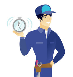 young asian mechanic holding alarm clock vector image