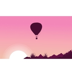 Silhouette of hot air balloon on pink backgrounds vector