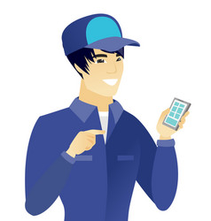 young asian mechanic holding a mobile phone vector image vector image
