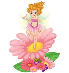 A fairy standing above the flower vector image