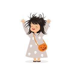cute little girl in halloween costume standing vector image