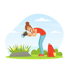 Young woman with camera taking photograph of vector