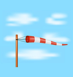 windsock in red and white design on blue sky vector image
