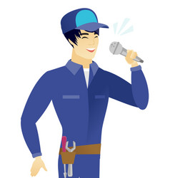 Young asian mechanic singing to the microphone vector