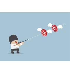 Businessman shoot two targets with one bullet vector image