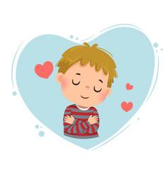 Little boy hugging himself vector