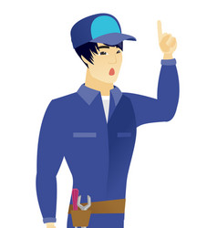 Asian mechanic with open mouth pointing finger up vector