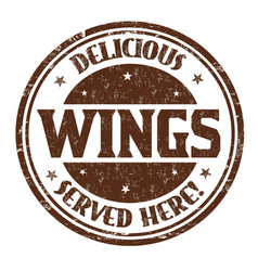 delicious wings sign or stamp vector image
