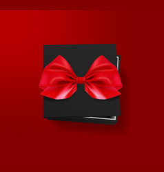 opened black gift box with red bow on red vector image