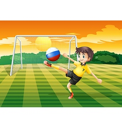 A girl kicking the ball with the Russian flag vector