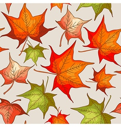 Seamless pattern with red and orange autumn leaves vector