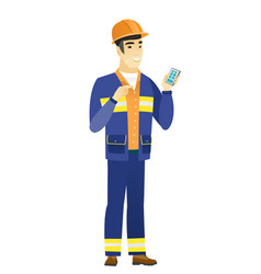 asian builder holding a mobile phone vector image