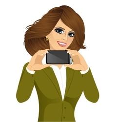 businesswoman displaying her smartphone vector image