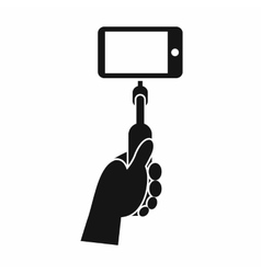 Hand holding a selfie stick with mobile phone icon vector image