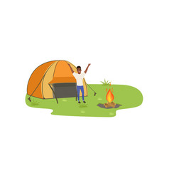 man camping in nature with fire in front of the vector image