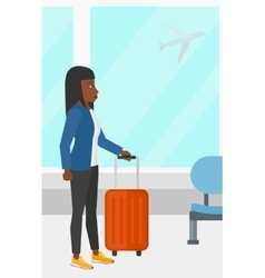 Woman at airport with suitcase vector