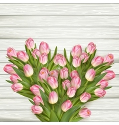 Colorful tulips on wooden table EPS 10 vector image vector image