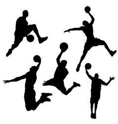 black silhouettes of a basketball player on a vector image