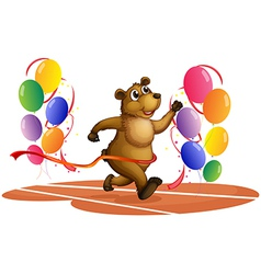 A bear running in the middle of colorful balloons vector image vector image