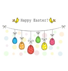 Easter eggs hanging on a rope vector image