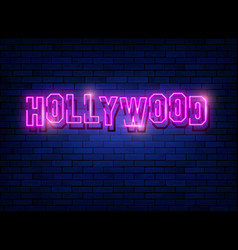 neon text hollywood with a brick wall vector image