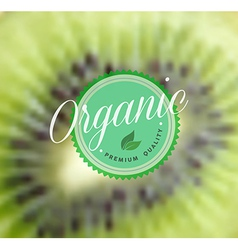Organic food retro label kiwi blurred background vector