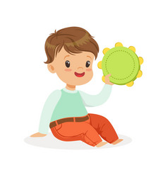 Cute little boy playing tambourine young musician vector