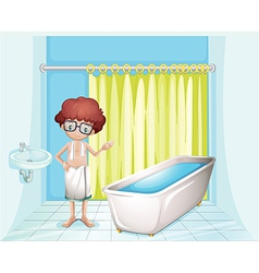 A boy standing inside the comfort room vector image vector image