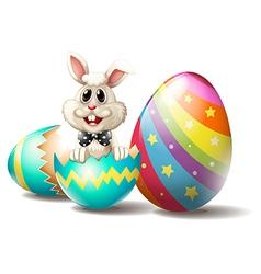 A rabbit inside cracked easter egg vector