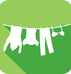 Clothes Hanging on a Clothesline Icon vector