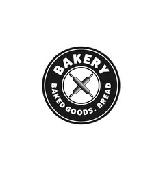 Crossed rolling pin vintage bakery logo designs vector