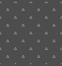 Tile pattern with triangles on black background vector