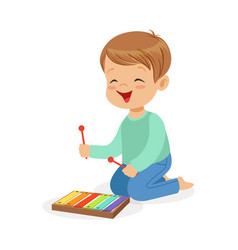 Cute little boy playing xylophone young musician vector