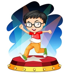 Little boy dancing on stage vector