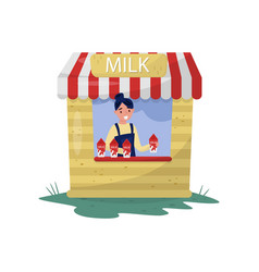 young cheerful girl selling milk in small stall vector image