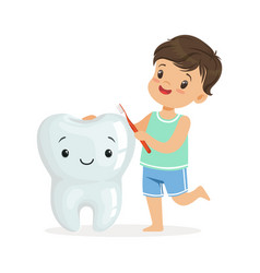 smiling boy brushing a big smiling toorh with a vector image vector image