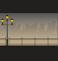 Silhouette of building with street lamp scenery vector