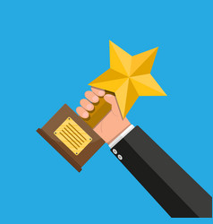 trophy winner gold star cup with wooden base vector image