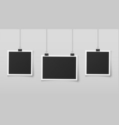 Hanging photo frames blank photos frame hangs on vector
